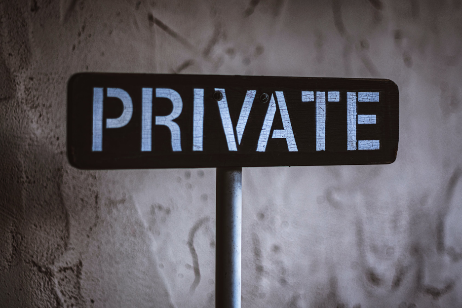 "a sign that says ""private"""